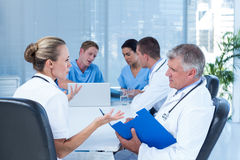 Team of doctors working on their files Royalty Free Stock Photography