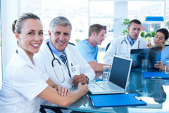 Team of doctors working on their files Stock Photography