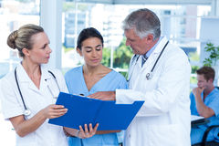 Team of doctors working on their files Royalty Free Stock Image