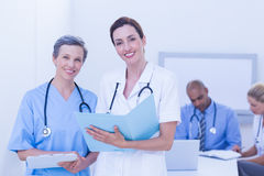 Team of doctors working on their files Stock Images
