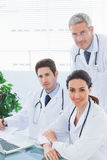 Team of doctors working together looking at camera Royalty Free Stock Photography
