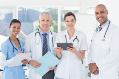 Team of doctors working together on patients file Stock Photos