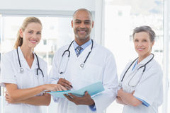 Team of doctors working together on patients file Royalty Free Stock Photo