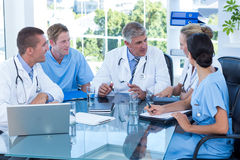 Team of doctors working together on patients file Royalty Free Stock Images