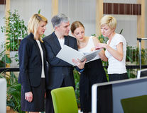 Team doing teamwork in office Stock Photos