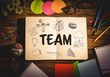 Team doodle on notepad surrounded by stationary. Digital composite of Team doodle on notepad surrounded by stationary Stock Image