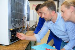 Team electrical appliance assembling stock image