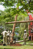 Team of electrician lineman. MASAKA, UGANDA - NOVEMBER 25: A unidentified team of electrician linemen work on a utility pole on November 25, 2013 in Masaka Stock Images
