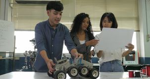 Team of electronics engineer working together, collaborating on a project to build robot.
