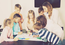 Team of elementary age children  drawing Royalty Free Stock Photography