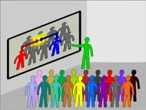 Team en el trabajo en una sala de clase Imagen de archivo libre de regalías