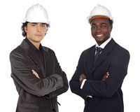 Team of engineers. Black and caucasian a over white background Royalty Free Stock Images