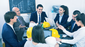 Team of engineers and architects discussing business project Royalty Free Stock Images