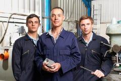 Team Of Engineers In Factory Fotografía de archivo