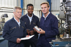 Team Of Engineers Having Discussion In Factory Stock Photography
