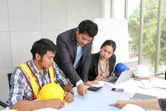 Team engineers working meeting room at the office. Team workers are talking construction plan. Electricians carpenter or Technical. Operaters and Labourers or royalty free stock photos