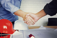 Team of engineers working together. Team of engineers working together in a architect office Stock Images
