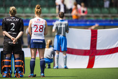 Team England with the flag during Hockey World Cup 2014. THE HAGUE, NETHERLANDS - JUNE 1: The English hockey team is lined up with their flag during the Hockey royalty free stock photography