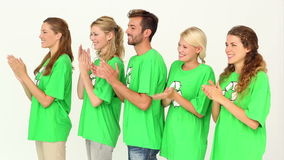 Team of environmental activists clapping stock footage