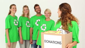 Team of environmental activists with one holding box stock video