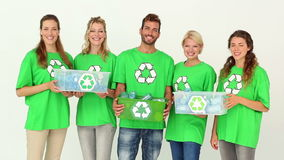 Team of environmental activists smiling at camera holding boxes stock footage