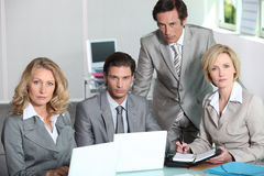 Team of executives. A serious team of executives royalty free stock image