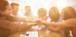 Team of executives forming hand stack in the office. Smiling team of executives forming hand stack in the office royalty free stock photo