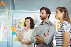 Team of executives looking at sticky notes. In office Royalty Free Stock Photography