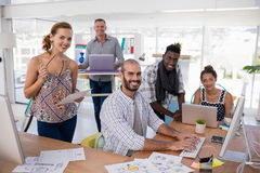 Team of executives working together at desk Stock Images