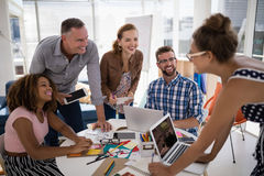 Team of executives working together in the office stock photos