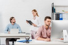 Team of executives working together. At modern office royalty free stock photo