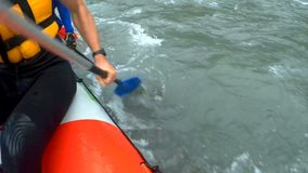 Team of experienced rafters moving across dangerous river, sports competition. Stock footage stock video footage