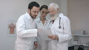 Team Of Experts Doctors Looking At Hospital Report. stock footage