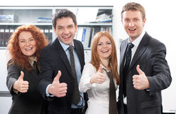 Team express positivity in office. Business team express positivity in office stock photography