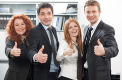 Team express positivity in office. Business team express positivity in office royalty free stock photography