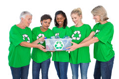 Team of female environmental activists holding box of recyclable Stock Images