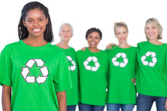 Team of female environmental activists smiling at camera Stock Image