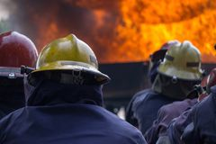 Team of fire fighters was trained to extinguishing huge flame stock photos