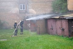 Fire brigade extinguishes fire Royalty Free Stock Photos