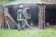 Firefighter extinguishes a fire Stock Image