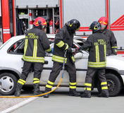 TEAM OF firefighters relieve an injured Royalty Free Stock Photo