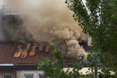 Team of firefighters at work on roof in real condition Stock Image