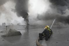 The team of firemen fighting with the fire royalty free stock images