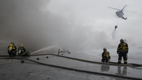 The team of firemen fighting with the fire Stock Photo