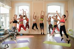 Team of fitness girls jumps together after training Stock Photography