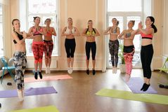 Team of fitness girls jumps together after training Royalty Free Stock Photos