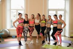 Team of fitness girls poses together after training Royalty Free Stock Photography