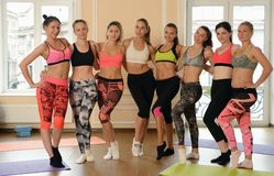Team of fitness girls poses together after training Royalty Free Stock Photo