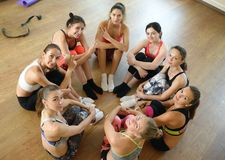 Team of fitness girls poses together after training Royalty Free Stock Image
