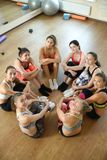 Team of fitness girls poses together after training Stock Photo